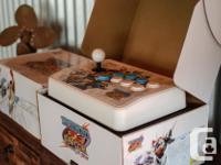 2x Wii (MadCatz) Tatsunoku vs Capcom Sticks in boxes
