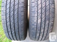Two tires on black GM steel rims (5 holes rims). Brand