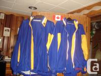 Men's and Ladies blue and yellow wind suits. Excellent