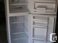 Two year old White GE Apartment Size fridge in