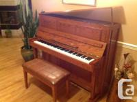 I am a gorgeous upright piano with padded bench and