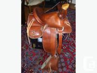 Beautiful, new Western horse saddle of an unmatched