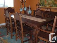 A rustic and unique Portuguese made dining room set in