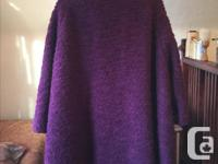 This is a fun and unique short purple vintage coat that