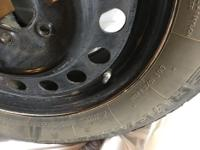 Selling a set of Uniroyal Tiger Paw snow tires on steel