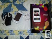I have an unlocked white Nokia 5230 with 1GB Memory