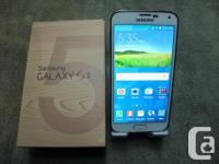 A very nice Samsung Galaxy S5 - UNLOCKED - white in