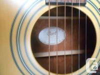 This is a virtually new Cort Earth 70 dreadnought