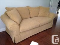 Custom made upholstered (gold colour) sofa from Urban