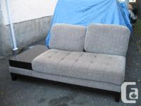 Upholstered loveseat with attached endtable as pictured