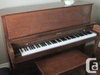 "Baldwin 44"" upright piano in  excellent condition.  One"