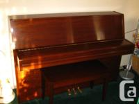 Upright Yamaha piano with custom made bench cover, in