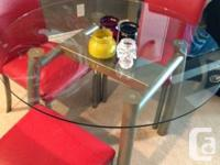 Glass + brushed aluminium dining set.  4 chairs