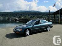 Honda Accord sedan. automatic. great on fuel and a