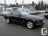 This 2007 Ford Mustang V6 Deluxe Coupe Sirius Radio