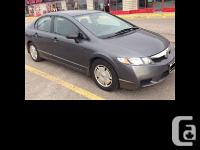 2009 Honda Civic DX-G Standard Features include. Alloy