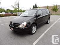 Have room for the whole gang. with this 2011 Kia Sedona