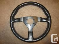 Momo steering wheel V35 with red stitches in terrific