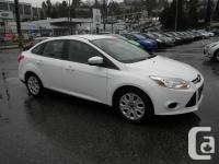 This 2014 Ford Focus SE Sedan Sync comes with our 'Buy