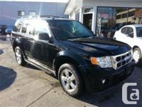 2010 Ford Escape XLT with 115.000 kilometers. This unit