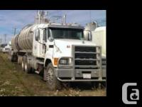 2011 Mack CH613 and 2011 Heil Dot 407 Trailer Front