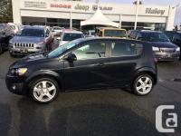 This 2015 Chevrolet Sonic has a 1.8L inline 4 cyl