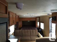 Sale price is $18,000 Canadian. Travel Trailer is