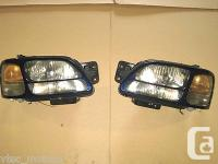 This auction is for a pair of: HID OEM Headlamps w/