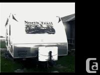 2012 Heartland North Trail 23FBS Travel Trailer. Mint