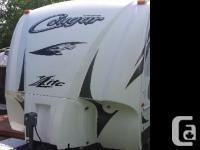2012 Keystone RV Cougar M-24RLS Travel Trailer Length