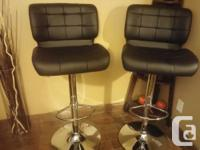 Brand new bar stools.Very comfy.Adjustable heights,foot