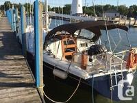 Beautiful clean ready to go anywhere sailing ship. Well