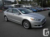 . This 2014 Ford Fusion SE AWD Nav Backup Cam Leather
