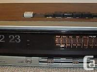 Offered is a vintage flip clock and AM FM radio radio