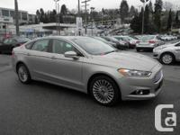 This 2015 Ford Fusion Titanium AWD Nav Sirius Radio