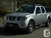 Get outside with this 2013 Nissan Frontier Pro-4X.