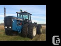 1993 Ford 846 four wheel-drive Tractor Blue exterior