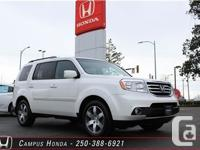 This is a stunning. pearl white 2012 Honda Pilot