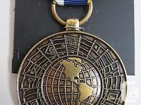 A full-size genuine Inter-American Defense Board Medal.
