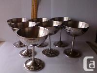 Offered is a set of seven very stylish polished