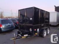 2011 BigTex 70SR High Side Enclosed Dump Trailer. 1
