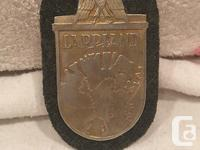 Up for auction is a WW2 German Badge / Arm Shield, for