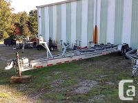 Large, heavy aluminum trailer. Tires are weathered but