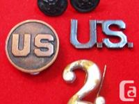 You are viewing a small group of two WWI era buttons,