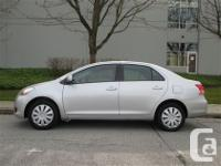 Economical and reliable Toyota Yaris sedan. 4 door.