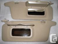 These BEIGE / TAN sun visors are in excellent pre-owned