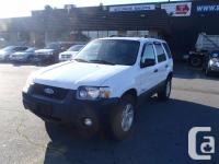 2007 Ford Escape Hybrid four wheel-drive. 2.3L. four
