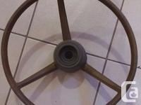 Mopar OEM Steering wheel tan in color. Pre-owned in