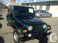 LET THE FUN BEGIN IN THIS LOW MILEAGE 2 DOOR 4X4. JUST