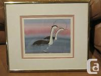 This is a beautifully framed and matted print of